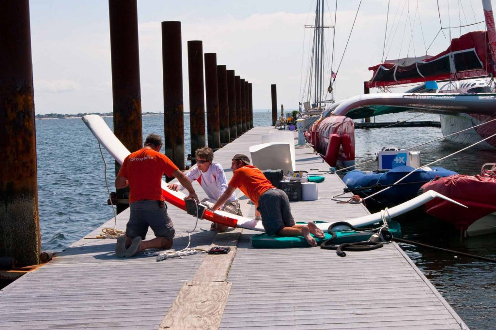 Groupama 3 Crew Doing Maintenance At Gateway Marina  (Photo by George Bekris)