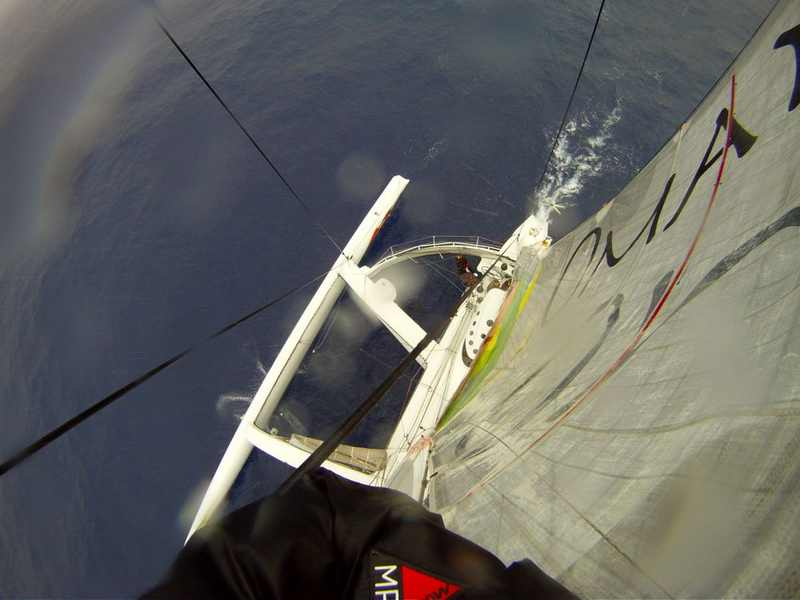 The View from the top - Michael Giles at the top of the mast 35m up (Photo by Mark Covell / Oman Sail)