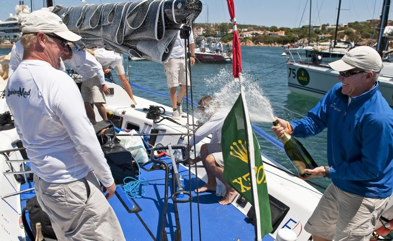 Tactician Terry Hutchinson sprays Jim Richardson in celebration of BARKING MAD's (USA) Championship win (Photo by Rolex / Kurt Arrigo)