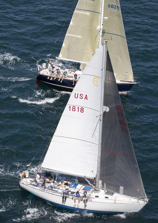 'Sinn Fein' a Cal 40 skippered by Peter S. Rebovich Sr. leads 'Frolic', a Sabre 362 owned by Peter Brown, in class 1 of the St David's Lighthouse at the start of the 635 mile Newport Bermuda Race(Photo by Daniel Forster / PPL)
