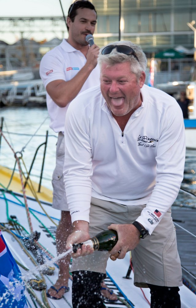 Brad Sprays Champagne in Celebration of First Sprint Win In Cape Town (Photo by Ainhoa Sanchez / Velux 5 Oceans)