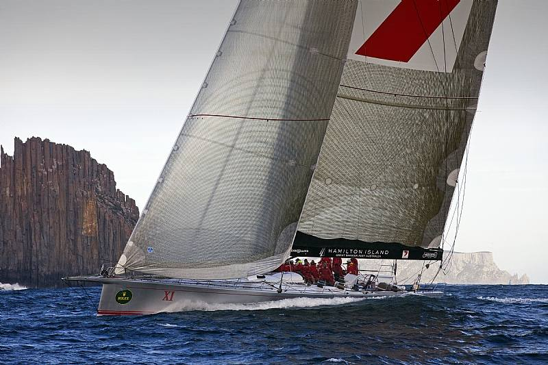 Provisional Line Honours Winner WILD OATS XI at the Organ Pipes, off Cape Raoul ( Photo by Rolex / Daniel Forster )