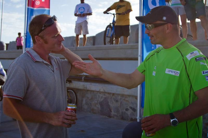 Gutek chats with Chris Stanmore-Major, after finishing 40 seconds ahead of him in Punta del Este, Uruguay, after racing thousands of miles across the Southern Ocean from New Zealand. (Photo by Ainhoa Sanchez/w-w-i.com)