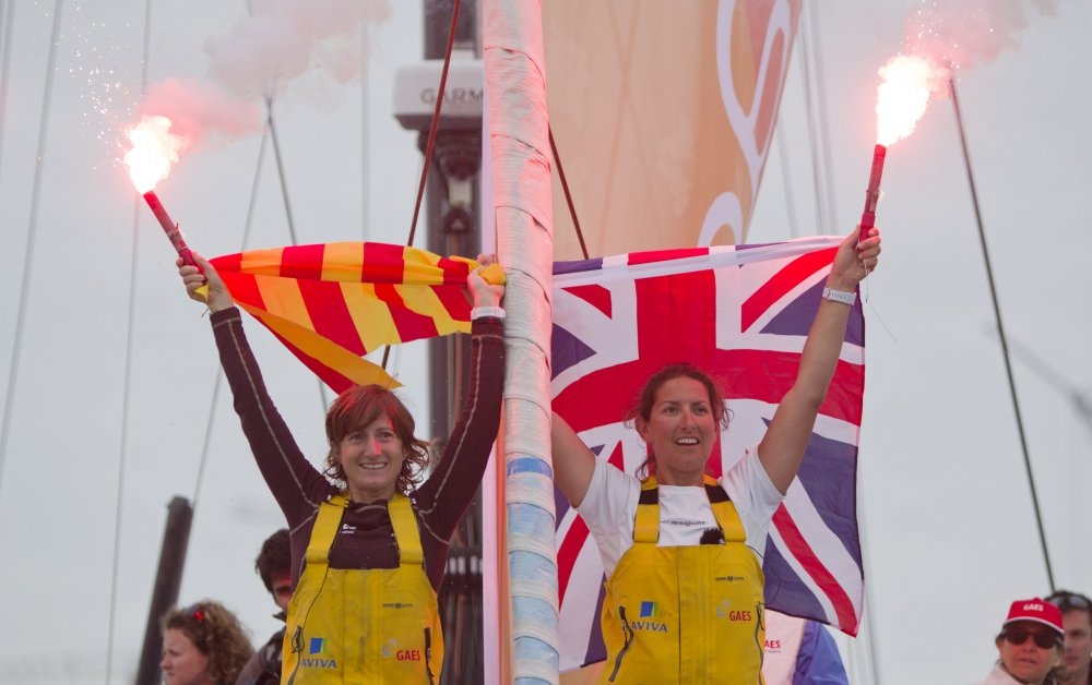 Anna Corbella and Dee Caffari Celebrate at Finish of Barcelona World Race (Photo by onEdition)