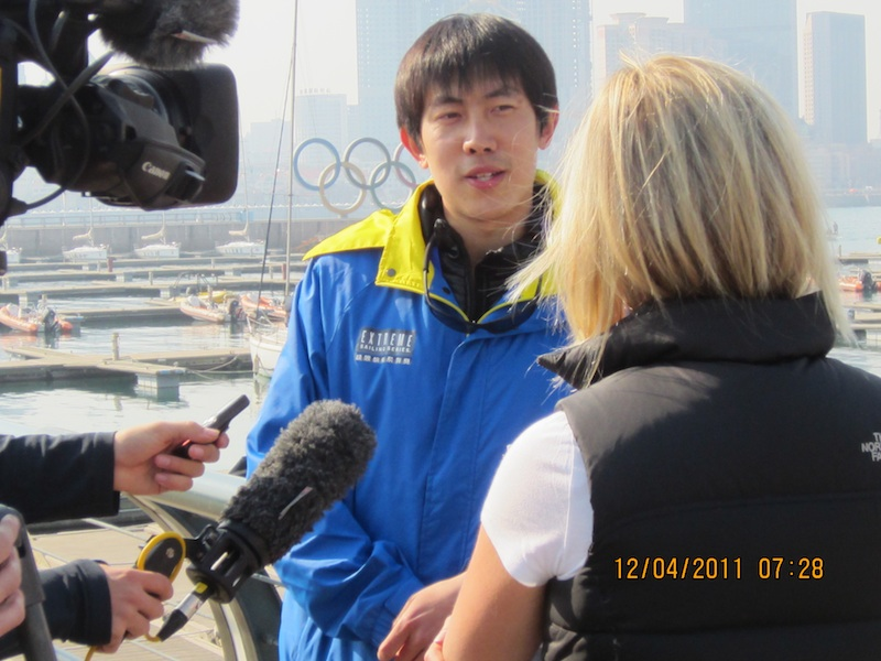 Leo Zhanglizhong, Project Officer Qingdao Sports Bureau Being Interviewed (Photo courtesy of Extreme Sailing Series)