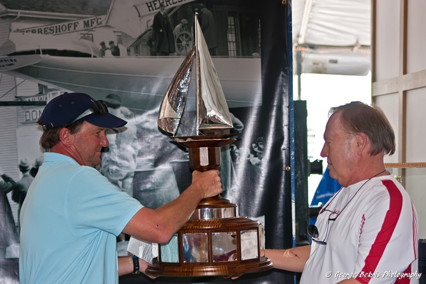 Trophy being presented to John Williams by Brad Read (Photo by George Bekris)
