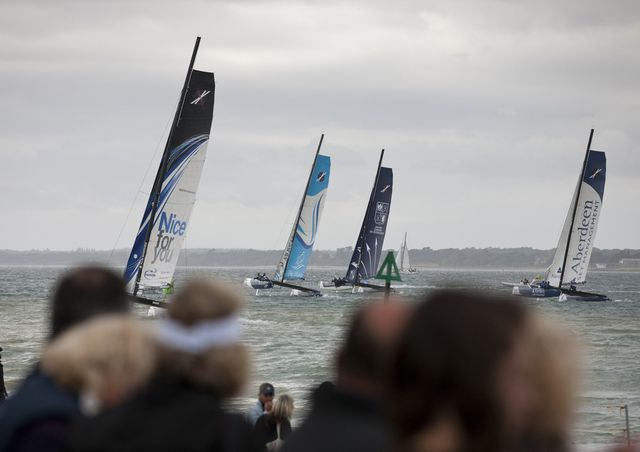 Spectators watch the Fleet From the race village (Photo by Lloyd Images)