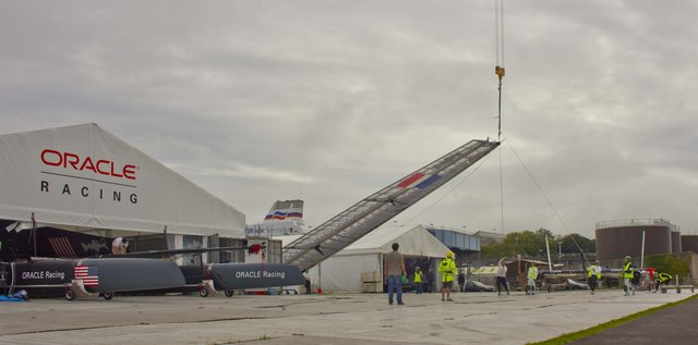 Crane lifting boat for launch (Photo by James Avery)