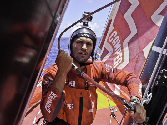 Mike Pammenter getting set to go up for a rig check CAMPER with Emirates Team New Zealand during leg 1 of the Volvo Ocean Race 2011-12, from Alicante, Spain to Cape Town, South Africa. (Credit: Hamish Hooper/CAMPER ETNZ/Volvo Ocean Race)