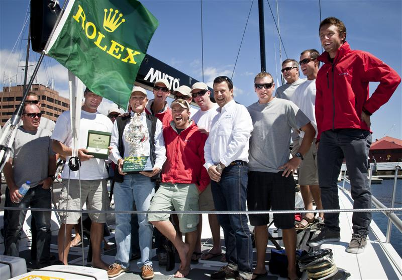 Stephen Ainsworth owner of LOKI with his crew and Patrick Boutellier Rolex Australia (Photo by Rolex /  Daniel Forster)