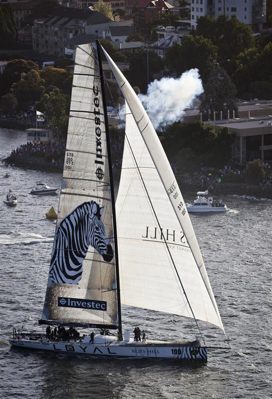 Investec Loyal crossing the finish line for Line Honours (Photo by Rolex / Daniel Forster)