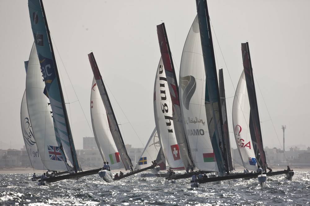 EX40 catamaran fleet in action during a practice day. Close to the Muscat shoreline (Photo © Lloyd Images)