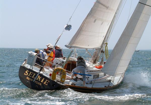 Sheila McCurdy's family boat Selkie powers upwind at the start of the 2008 Newport Bermuda Races. Selkie will see her 10th Newport Bermuda Race in 2012. McCurdy has been aboard on all the races, 3 as navigator for her father Jim McCurdy, the boat's designer and 6 as both skipper and navigator. In 2008 Selkie finishes 2nd in class and 2nd in the St. David's Lighthouse Division.  (Photo by Talbot Wilson)