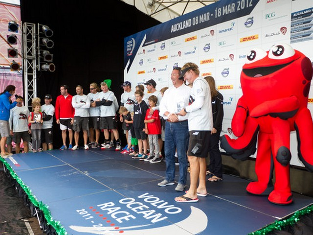 Jan Gurander, Chief Financial Officer Volvo Car Corporation, presents PUMA Ocean Racing powered by BERG, skippered by Ken Read from the USA, with the 2nd place trophy for the Auckland In-Port Race, during the Volvo Ocean Race 2011-12. (Photo by Ian Roman / Volvo Ocean Race)