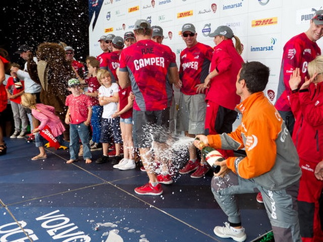 Groupama Sailing Team skipper Franck Cammas sprays champagne over winners CAMPER with Emirates Team New Zealand, skippered by Chris Nicholson from Australia, after the Auckland In-Port Race, during the Volvo Ocean Race 2011-12. (Photo by Ian Roman / Volvo Ocean Race)