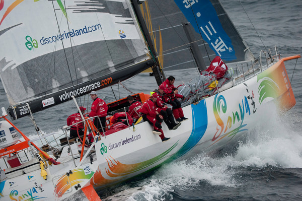 Mike Sanderson and Team Sanya Lead the Volvo Ocean Race fleet out of Auckland, New Zealand at the start of leg 5 ( Photo by Paul Todd / Volvo Ocean Race )