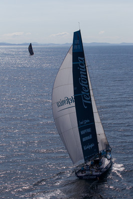 Team Telefonica, skippered by Iker Martinez from Spain, as they chase PUMA Ocean Racing powered by BERG, skippered by Ken Read from the USA, in the final miles of leg 5 from Auckland, New Zealand to Itajai, Brazil, in the Volvo Ocean Race 2011-12. ( Photo by  IAN ROMAN/Volvo Ocean Race)