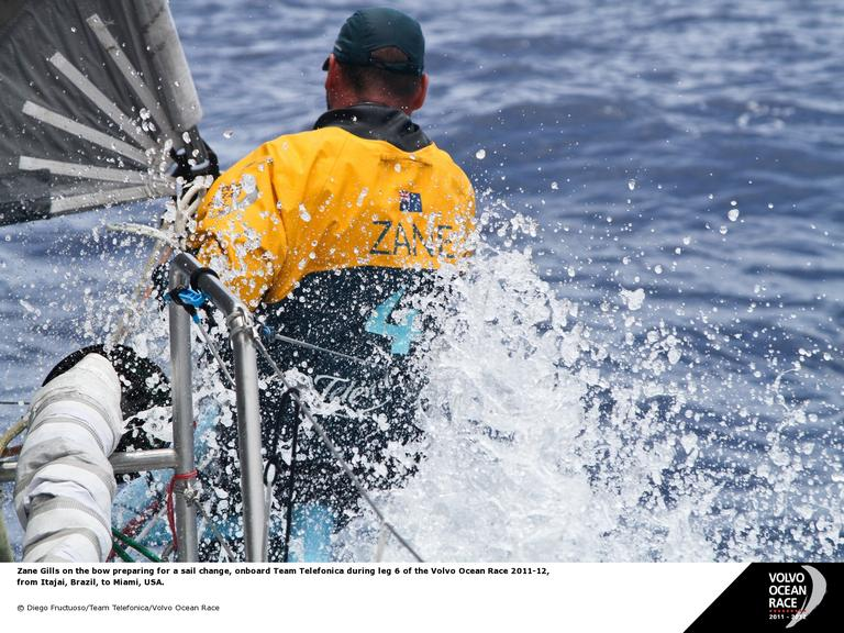 Diego Fructuoso/Team Telefonica/Volvo Ocean Race Zane Gills on the bow preparing for a sail change, onboard Team Telefonica during leg 6 of the Volvo Ocean Race 2011-12, from Itajai, Brazil, to Miami, USA.( Diego Fructuoso/Team Telefonica/Volvo Ocean Race)