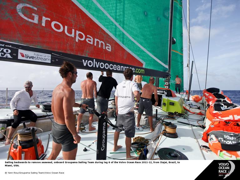 Sailing backwards to remove seaweed, onboard Groupama Sailing Team during leg 6 of the Volvo Ocean Race 2011-12, from Itajai, Brazil, to Miami, USA. (Photo by Yann Riou/Groupama Sailing Team/Volvo Ocean Race)