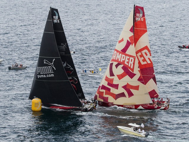 PUMA Ocean Racing powered by BERG, skippered by Ken Read from the USA chases down CAMPER with Emirates Team New Zealand, skippered by Chris Nicholson from Australia, to take third place in the PORTMIAMI In-Port Race, during the Volvo Ocean Race 2011-12. (Photo by  IAN ROMAN/Volvo Ocean Race)