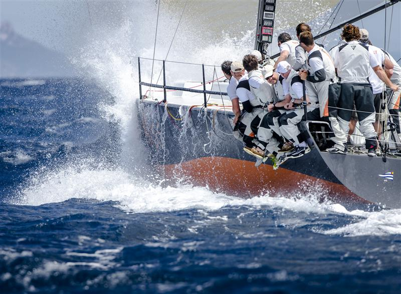 NEAR MISS (SUI) in a challenging downwind leg (Photo by Rolex / Kurt Arrigo)