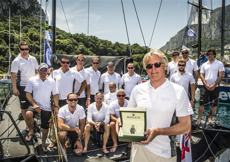 Sir. Peter Ogden, owner of JETHOU (GBR) receives a Rolex timepiece for his overall win at the Rolex Volcano Race (Photo by Rolex / Kurt Arrigo)