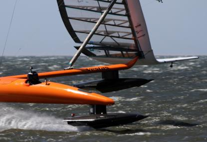 Paul Larsen and Sailrocket 2  blasting through another record day (Photo courtesy of Vestas Sailrocket)