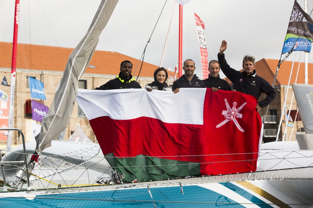 Oman Flag and the Oman Air Crew onboard MOD70 Oman Air-Musandam