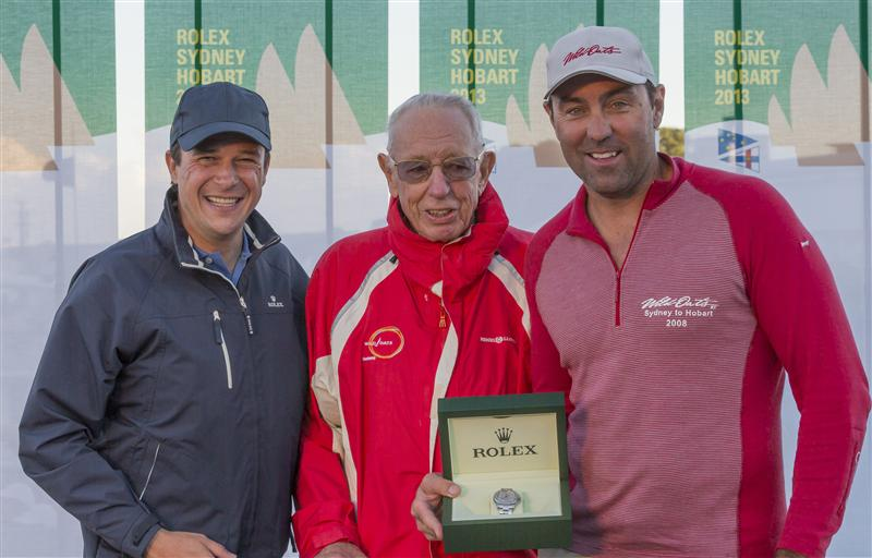 BOB OATLEY, OWNER OF WILD OATS XI AND SKIPPER MARK RICHARDS RECEIVE THE ROLEX YACHTMASTER TIMEPIECE