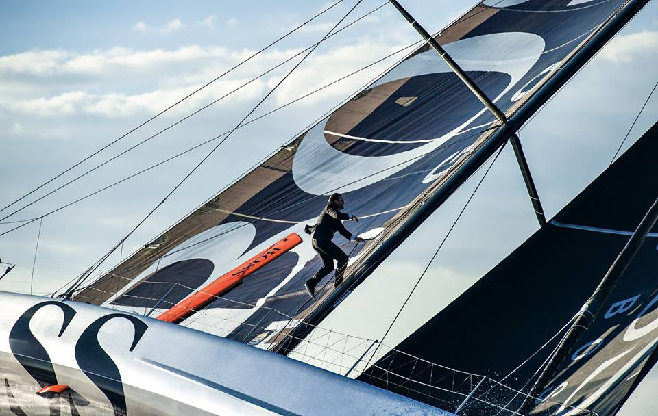 Alex Thomson waking the mast on Hugo Boss (Photo by Mark Lloyd / Alex Thomson Racing)