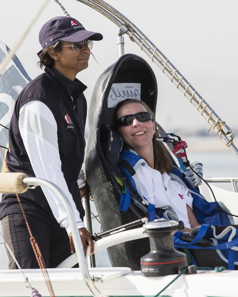 Hilary Lister British quadriplegic sailor( paralysed from the neck down) and Nashwa Al Kindi (OMA) shown here finishing their trans-ocean crossing from Mumbai - Muscat. Oman. Onboard a specially adapted Dragonfly trimaran. Credit - Lloyd Images
