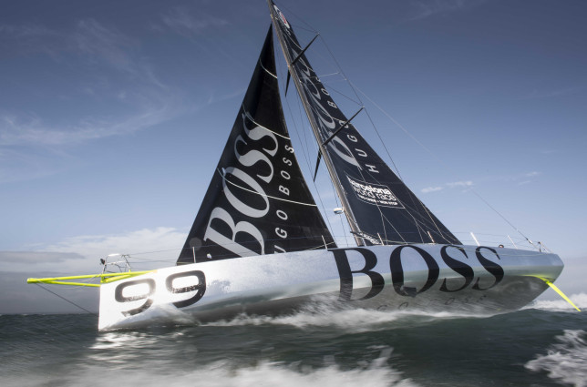 Pictures of offshore sailor Alex Thomson's new Hugo Boss IMOCA Open 60 training in the Solent. UK Credit - Lloyd Images