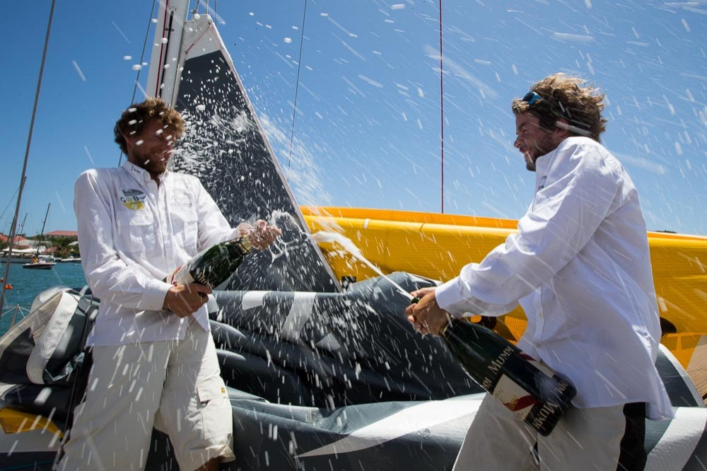 Left to right: Paul Meilhat and Gwenolé Gahinet celebrate their win at the end of the Transat AG2R La Mondiale from Concarneau to St. Barthelemy in the Caribbean.(Photo by Copyright ALEXIS COURCOUX)