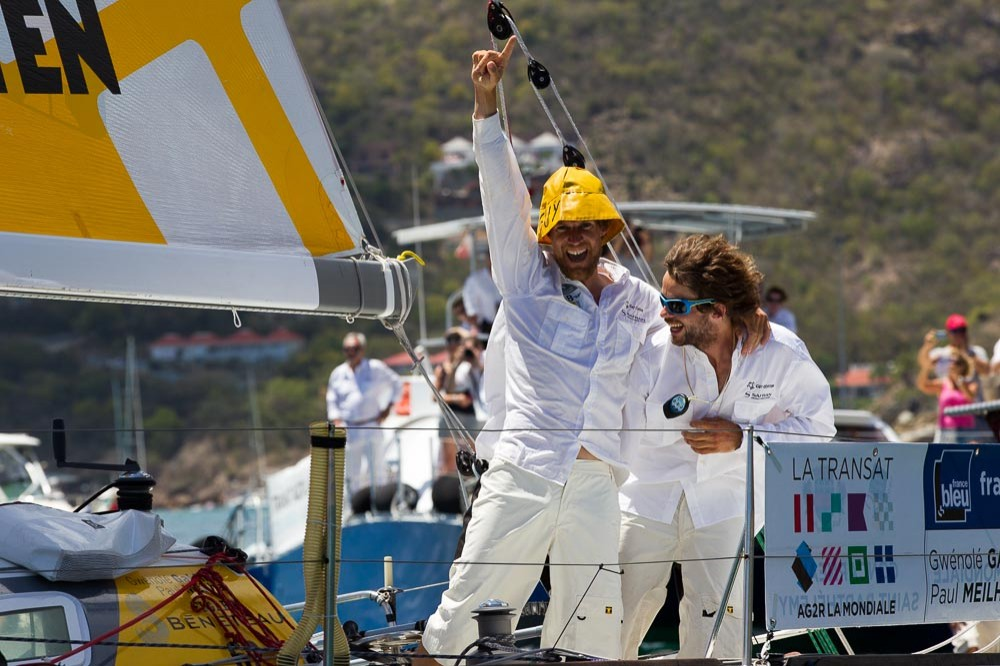 Left to right: Paul Meilhat and Gwenolé Gahinet celebrate their win at the end of the Transat AG2R La Mondiale from Concarneau to St. Barthelemy in the Caribbean.Copyright ALEXIS COURCOUX