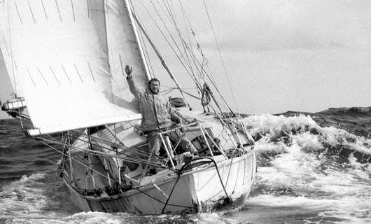 Circa 22nd April 1969: Robin Knox-Johnston waving aboard his 32ft yacht SUHAILI off Falmouth, England after becoming the first man to sail solo non-stop around the globe. Knox-Johnston was the sole finisher in the Sunday Times Golden Globe solo round the