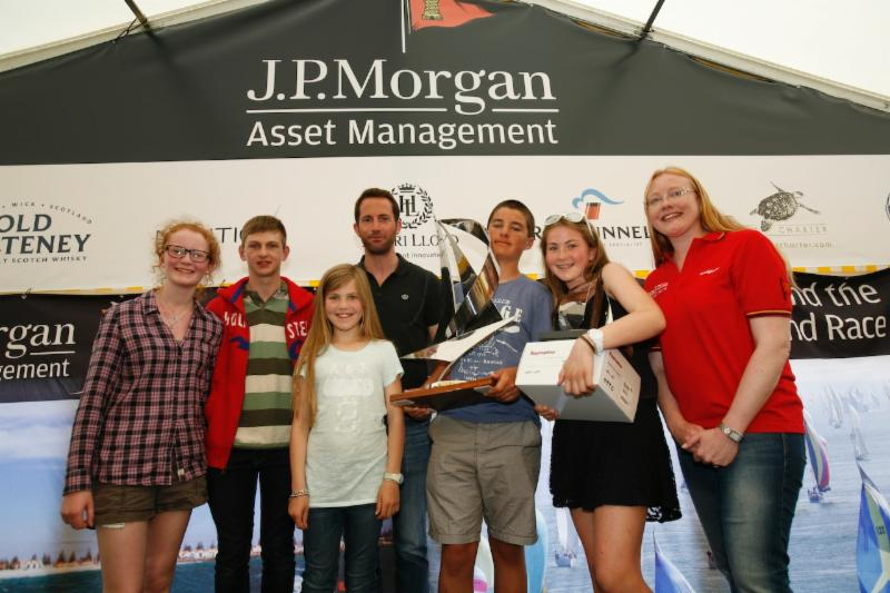 The 2014 Raymarine RIR Young Sailor Trophy was awarded to Christopher Barker from Surrey, who was joined on stage by his siblings, Sir Ben Ainslie and Corrie McQueen from J.P. Morgan Asset Management. Photo: Patrick Eden
