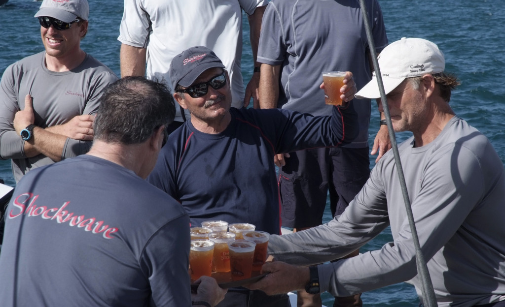 George Sakellaris, owner of the first to finish yacht Shockwave celebrates with Gosling's Dark 'n Stormy drink with his crew on arrival at the Royal Bermuda YC dock. Photo Barry Pickthall/PPL