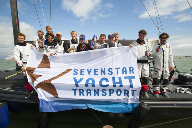 Celebrations for Varuna on the dock after crossing the finish of the Sevenstar Round Britain and Ireland Race - Credit: Patrick Eden/RORC