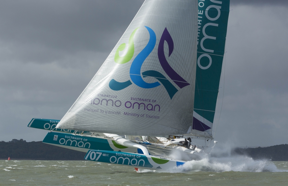 The Seven Star Round Britain and Ireland, race start. Cowes. Isle of Wight. The Oman Sail MOD70 trimaran in action, skippered by Sidney Gavignet (FRA) Please Credit: Lloyd Images