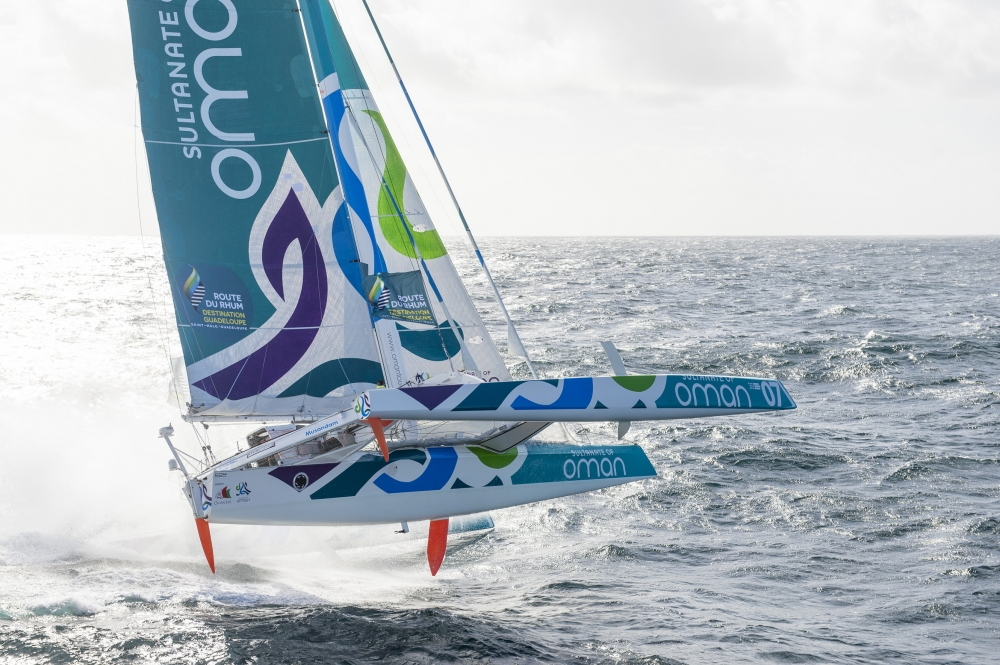 "Sidney Gavignet (FRA) onboard the Oman sail MOD70 trimaran ""Musandam"". Shown here training offshore prior to the Route du Rhum 2014 Credit: Vincent Curutchet/Lloyd Images"