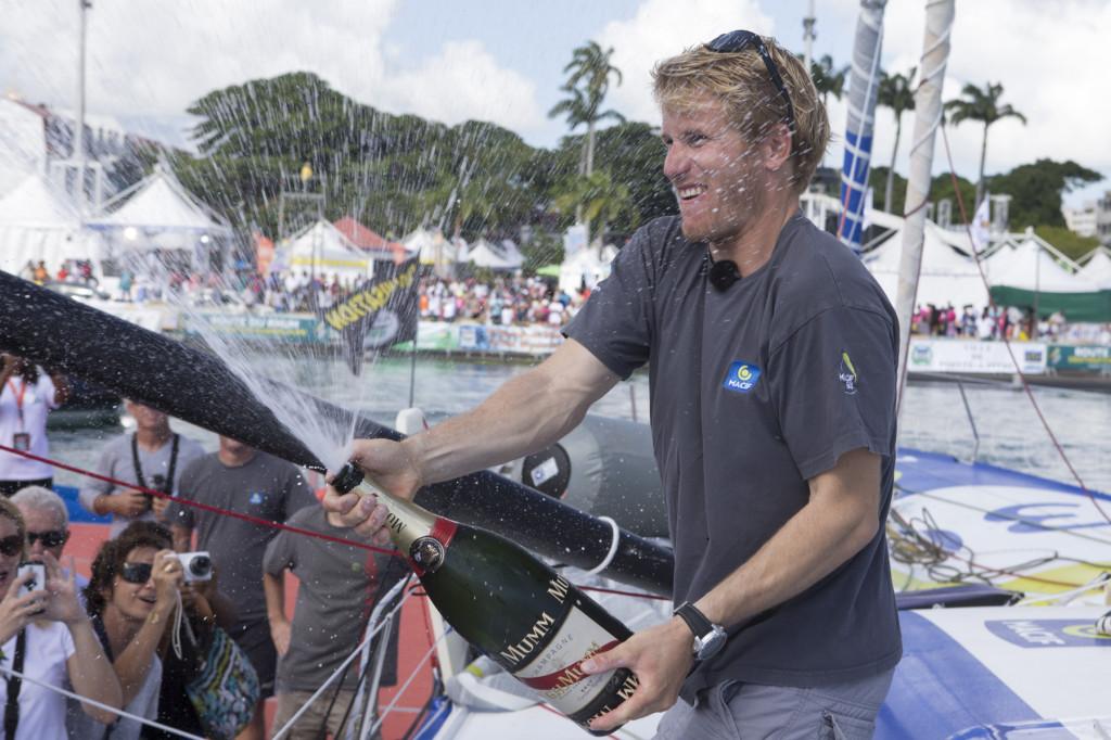 Francois Gabart (Macif) vainqueur de la categorie Imoca sur la Route du Rhum-Destination Guadeloupe 2014 en 12j 04h 38mn et 55 sec - Pointe a Pitre le 14/11/2014 (Photo © Alexis Courcoux)