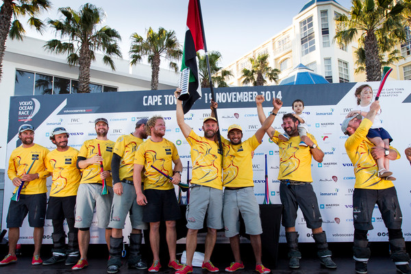 November 5, 2014. Abu Dhabi Ocean Racing celebrate on stage after crossing the finish line in Cape Town as the winners of Leg 1. (Photo © Ian Roman/Volvo OCean Race)