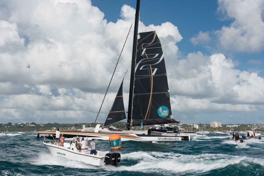 Yann Guichard and Spindrift 2 at the arrival of the Route du Rhum 2014 in Pointe-à-Pitre, Guadeloupe, France. (Photo © Chris Schmid/Spindrift racing, all right reserved)