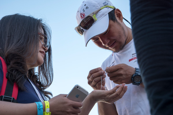 November 5, 2014. Dongfeng Race Team arrive in Cape Town in second place for Leg 1; Jiru Yang, aka Wolf meets his mother. (Photo © Sam Greenfield/Volvo Ocean Race)