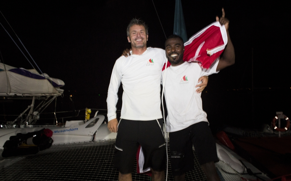Sidney Gavignet and shore crew member Suliman Al Wahaibi happily celebrate Musandam's arrival in Guadaloupe (Photo © Mark Lloyd/Lloyd  Images)