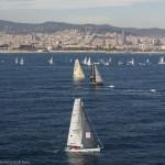 Hugo Boss leads the fleet off at the start of the Barcelona World Race