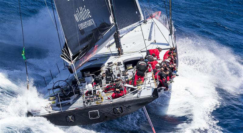 COMANCHE (USA) crashing through the waves on the way south to Tasmania Race Start COMANCHE, Sail n: 12358, Bow n: 58, Design: Verdier Yacht Design & Vplp, Owner: Jim Clark & Kristy Hinze-Clark, Skipper: Ken Read (Photo by Rolex/Carlo Borlenghi)