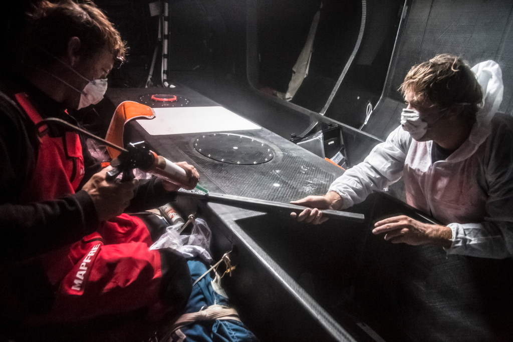 March 22, 2015. Leg 5 to Itajai onboard MAPFRE. Day 04. Skipper Iker Martinez glues on of the battens to stick to the hull (Francisco Vignale / MAPFRE / Volvo Ocean Race)