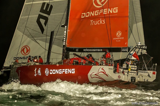 Team Dongfeng crossing the finish line to Win Leg 6 of the Volvo Ocean Race (Photo by George Bekris)