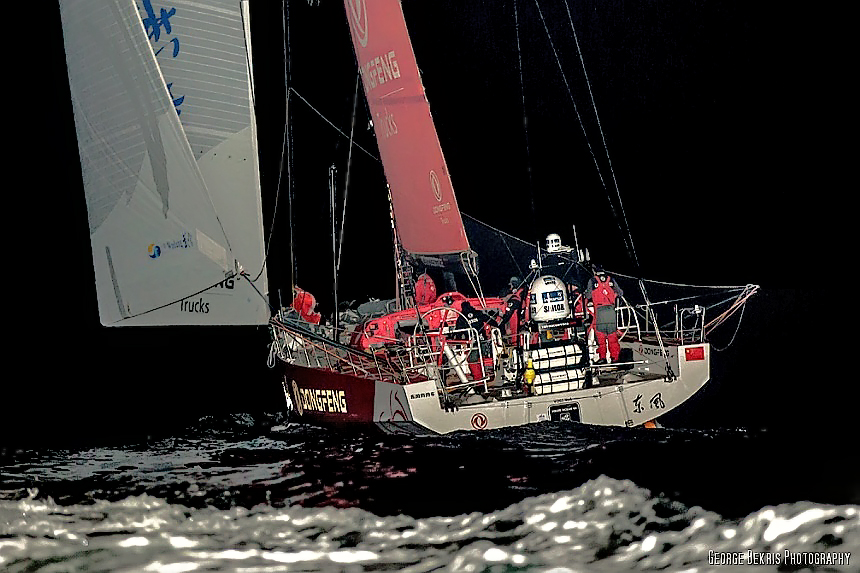 Team Dongfend pass Castle Hill headed for the finish in Newport, Rhode Island (Photo by George Bekris)